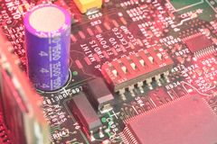 Motherboard with jumpers. Red microcircuit (server motherboard) with jumpers background Royalty Free Stock Image