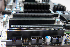 Motherboard slots. Motherboard aerial view with additional board slots in focus Stock Photo