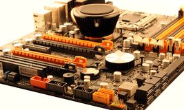Motherboard overview. South and north bridge passive cooline, memory and pci-e slots, communicatio nand usb ports royalty free stock photo