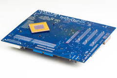 Motherboard And Processor. On White Background Stock Photos