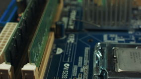 Motherboard with RAM spinning on the stand, slot for memory closeup stock footage