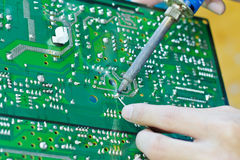 Motherboard repair Royalty Free Stock Photo