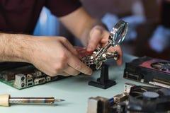 Motherboard repair stock photography