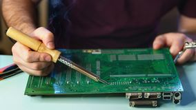 Motherboard repair stock images