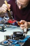 Motherboard repair royalty free stock images