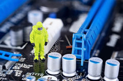 Motherboard repairing or cleaning concept Royalty Free Stock Image