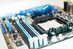 Motherboard on a table close-up. Bright light Stock Photos