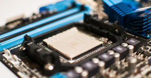 Motherboard on a table close-up. Bright light Royalty Free Stock Photo