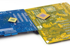 Motherboards And Processors. Two Motherboards And Processors On White Background stock images