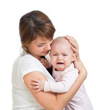 Mothercalming her crying baby isolated Stock Images
