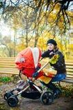 Motherhood And Autumn Royalty Free Stock Photography