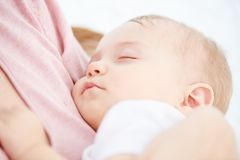 Childhood. little baby sleeping. Breast feeding Royalty Free Stock Images