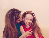 Motherhood is pure joy. Beautiful young woman hugging little gir Royalty Free Stock Photos