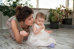Motherhood - woman and her little daughter Stock Photo