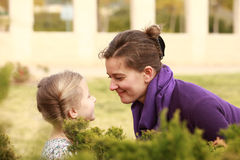 Mothering. Mother and daughter love families day autumn sun Royalty Free Stock Image