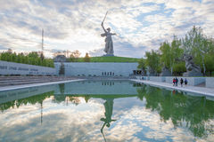 The Motherland Calls monument with its reflection. Volgograd, Russia - May 2, 2015: The Motherland Calls monument with its reflection in lake. It is a statue in Royalty Free Stock Photo