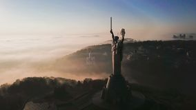 The Motherland Monument. Kiev Ukrainian capital popular tourist places to visit. Aeriel drone video footage from the top. Foggy autumn morning in Kiev. The stock footage