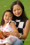 Motherly love. Lovely Girl In Mother's Arm Stock Images