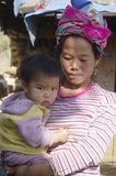 Motherly Love. A Black Hmong woman and baby Stock Photo