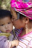 Motherly Love. A Black Hmong woman and baby Stock Photography