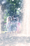 Motherly but sexy. Three young pregnant women having fun against a fountain in the park Royalty Free Stock Photography