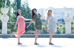 Motherly but sexy. Three young pregnant women having fun in the park Royalty Free Stock Image