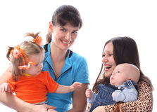 Mothers with babies. Two mothers with babies. Isolated Stock Images