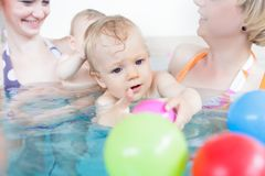 Mothers being happy about their babies playing with each other stock photo