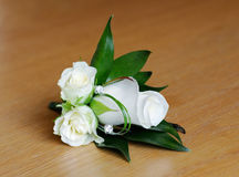Mothers boutonniere or corsage. Mothers corsage is white rose on wedding day stock photography