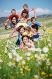 Mothers with children. In flower field Stock Photography
