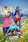 Mothers with children. In flower field Royalty Free Stock Photos