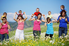 Mothers with children. In flower field Royalty Free Stock Image