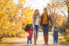 Mothers and children in autumn Park Royalty Free Stock Images