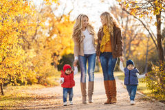 Mothers and children in autumn Park Stock Photo