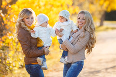 Mothers and children in autumn Park Royalty Free Stock Photography