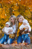 Mothers and children in autumn Park Royalty Free Stock Photos