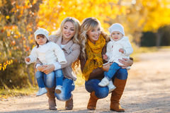 Mothers and children in autumn Park Royalty Free Stock Image