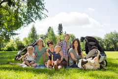 Mothers And Children Enjoying Picnic Stock Photo