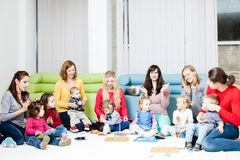 Mothers and children. Mothers with her children clap in the hands and plays Stock Photo
