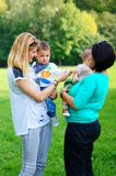 Mothers and children. Mothers with their children at a park in Poznan, Poland Stock Image