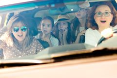 Mothers with daughters scared in car - looking amazed by incoming accident royalty free stock photos
