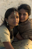 Mothers and daughters of the world. An indian mother and her daughter posing on the beach Stock Photos