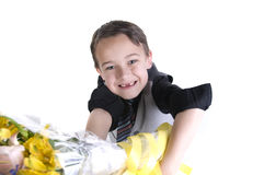 Mothers day 04. Image of small boy in suit presenting flowers as a gift Royalty Free Stock Photos