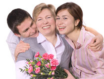 Mothers day. Mother receives a bunch of tulips from her children Stock Photography