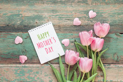 Mothers day background with pink tulips and hearts on green grun Stock Photography