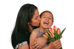 Mothers Day. Beautiful girl and her mother celebrating mothers day Stock Image
