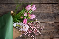 Mothers day bouquet on old wood stock photography