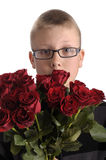 Mothers day. Boy with bouquet of red roses. Isolated on white background stock photo