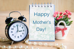 Mothers day card and alarm clock. Royalty Free Stock Images
