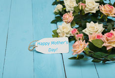 Mothers day card and  beautiful roses on blue wooden background Stock Photo